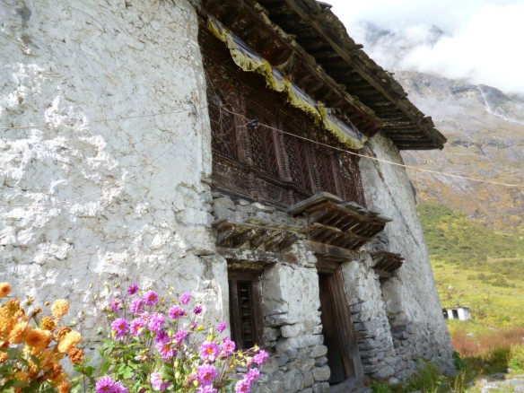 Langtang Gompa with flowers outside (c) Temba Lama